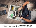 senior man assembling a desktop ... | Shutterstock . vector #787397965