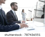 employees working on computers | Shutterstock . vector #787436551