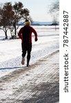 man jogging during winter   Shutterstock . vector #787442887