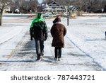 couple walking during winter   Shutterstock . vector #787443721