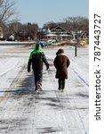 couple walking during winter   Shutterstock . vector #787443727