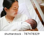 asian mother carrying infant in ... | Shutterstock . vector #787478329