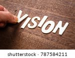 Small photo of Hand arrange wood letters as VISION word