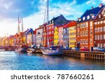 Small photo of Scenic summer sunset view of Nyhavn pier with color buildings, ships, yachts and other boats in the Old Town of Copenhagen, Denmark