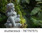 Cupid Sculpture In The Garden ...