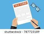 businessman signs a tax form. a ...   Shutterstock .eps vector #787723189