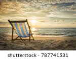 empty deck chair on secluded... | Shutterstock . vector #787741531