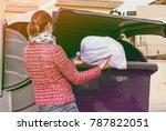 Small photo of Woman throw away bag