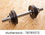 barbell on wood   Shutterstock . vector #78785572