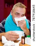 Small photo of The white man tries to stop the runny nose. Doing self-medication.