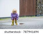 children in rubber boots. wet ... | Shutterstock . vector #787941694