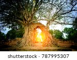 Small photo of The Miracle of Gate way to the passage of time with arch is surrounded by bodhi Tree in Wat Phra Ngam ( Old buddhist temple ) Ayutthaya ,Thailand.