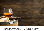 glass of cognac with a cigar on ... | Shutterstock . vector #788002894