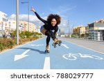 young fit black woman on roller ... | Shutterstock . vector #788029777