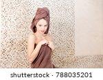young woman relaxing in a sauna ... | Shutterstock . vector #788035201