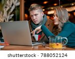 girl with a man working on a... | Shutterstock . vector #788052124