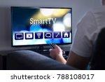 man watching smart tv. choosing ... | Shutterstock . vector #788108017