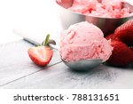 Small photo of Delicious strawberry ice cream scoop with fresh strawberries on wooden background