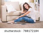 beautiful young woman at home... | Shutterstock . vector #788172184
