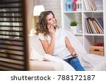 beautiful young woman at home... | Shutterstock . vector #788172187