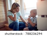 mother playing with her son... | Shutterstock . vector #788236294