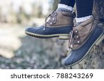 Close Up Of Duck Boots And...