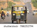 Small photo of Jaisalmer, India - November 16, 2017: An auto rickshaw driver driving his vehicle in the road.