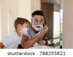 father and son shaving together ... | Shutterstock . vector #788255821
