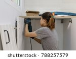 young woman using electric... | Shutterstock . vector #788257579