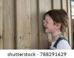 young girl peering through hole ... | Shutterstock . vector #788291629