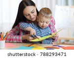 mother helping her child son to ... | Shutterstock . vector #788293471
