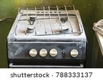 An Old Dirty Gas Stove In An...