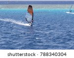 windsurfer on a board under a... | Shutterstock . vector #788340304