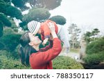 young asian mother holding and...   Shutterstock . vector #788350117