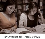 two female student reading a... | Shutterstock . vector #788364421