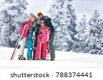 family together skiing on snowy ... | Shutterstock . vector #788374441