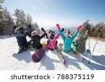 Happy Skiers Sitting On Snow I...