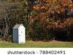 Vintage White Outhouse In The...