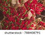 Red Tulip Flowers In Brown...
