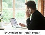 businessman in suit talking on... | Shutterstock . vector #788459884