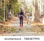 Stock photo woman running and walking in beautiful park with akita dog 788487994