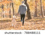 Jogger And Akita Dog Outdoors