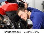Motorcycle Mechanic Listening...
