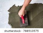 worker hand with trowel tool... | Shutterstock . vector #788513575