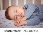 the child sleeps in the gray... | Shutterstock . vector #788530411