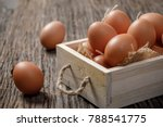 fresh chicken egg in wooden box ... | Shutterstock . vector #788541775