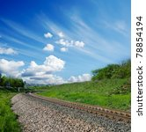 railway under cloudy sky - stock photo