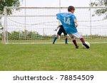 boy kicking a penalty at goal | Shutterstock . vector #78854509