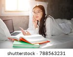 happy student studying with a... | Shutterstock . vector #788563231