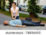 woman makes first aid for a man ... | Shutterstock . vector #78856453